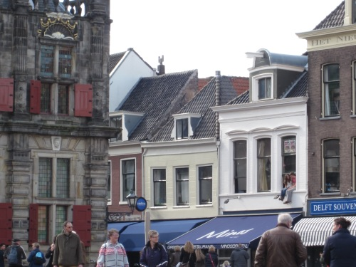 On the markt in Delft-- I love when people sit in the windows